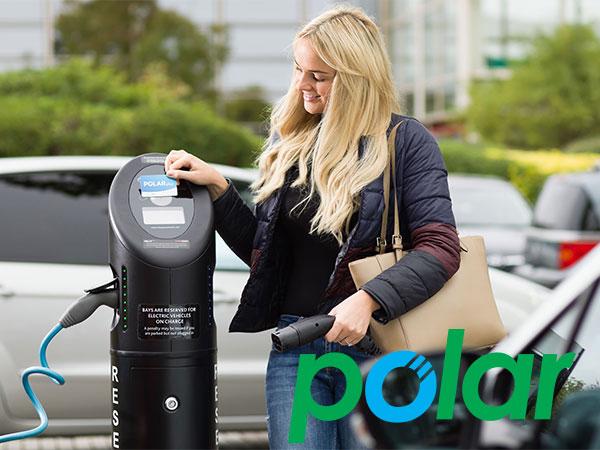 POLAR network woman using electric car charging post