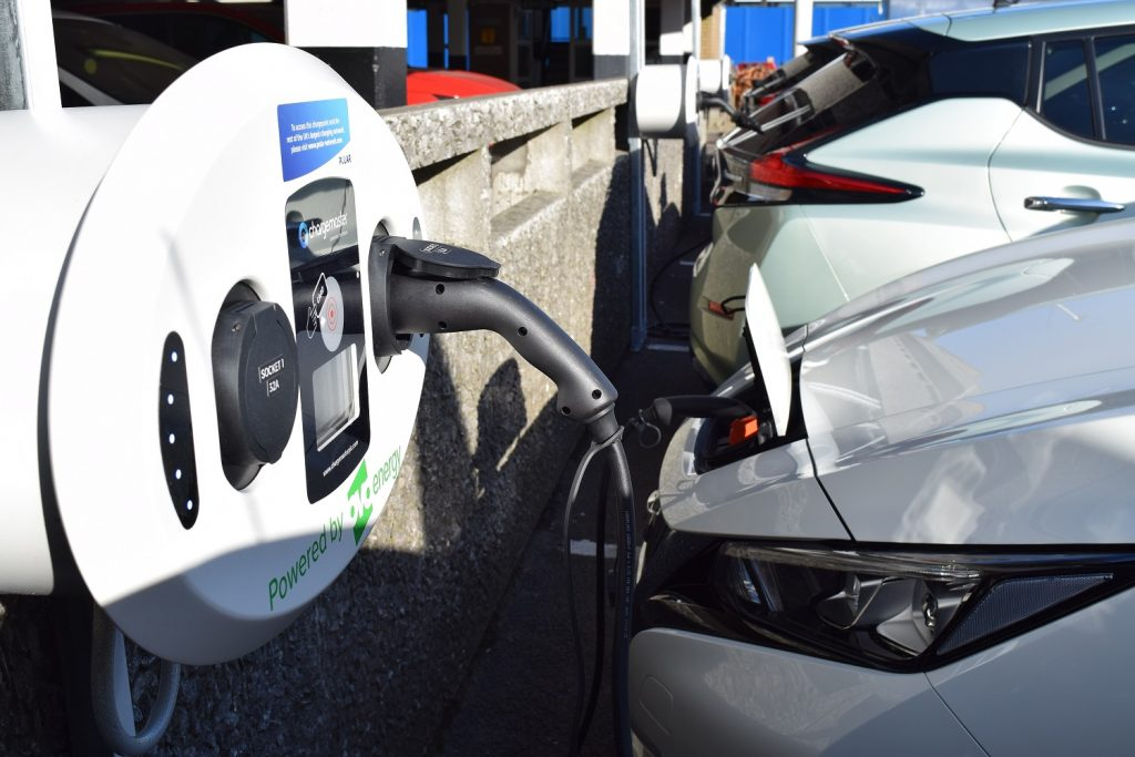 Car electric vehicle charging at public wallbox