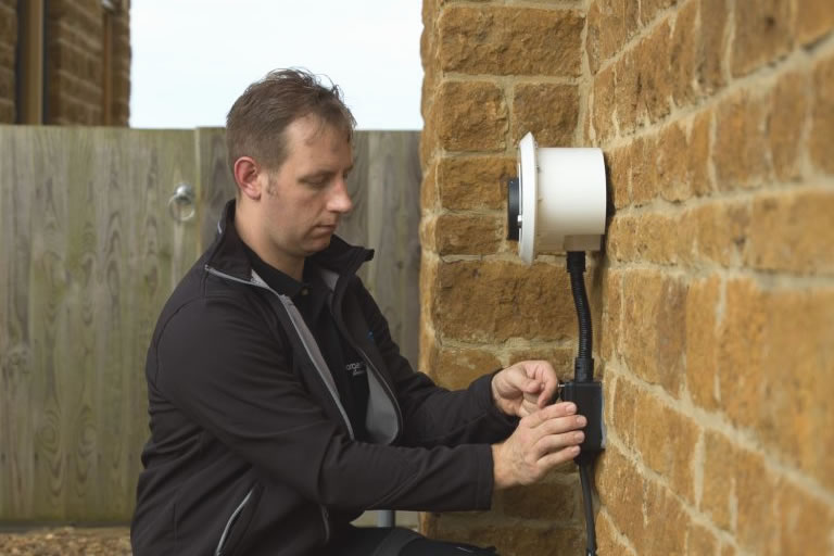 chargemaster engineer installing homecharge unit